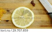 Купить «Various spices with lemon slice and knife on chopping board 4k», видеоролик № 29707859, снято 5 июня 2017 г. (c) Wavebreak Media / Фотобанк Лори