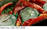 Купить «Flavored ice cubes with herb and dried red chili pepper 4k», видеоролик № 29707935, снято 5 июня 2017 г. (c) Wavebreak Media / Фотобанк Лори