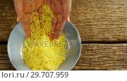 Купить «Hands pouring rice in a bowl 4k», видеоролик № 29707959, снято 5 июня 2017 г. (c) Wavebreak Media / Фотобанк Лори