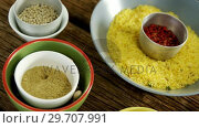 Yellow rice with various spice on wooden table 4k. Стоковое видео, агентство Wavebreak Media / Фотобанк Лори