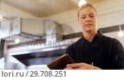 Купить «Waitress ringing order bell at counter 4k», видеоролик № 29708251, снято 21 мая 2017 г. (c) Wavebreak Media / Фотобанк Лори
