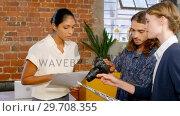 Купить «Executive with colleague having discussion over graphics 4k », видеоролик № 29708355, снято 21 мая 2017 г. (c) Wavebreak Media / Фотобанк Лори