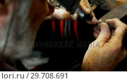 Купить «Senior goldsmith manufacturing bangle in workshop 4k», видеоролик № 29708691, снято 10 июня 2017 г. (c) Wavebreak Media / Фотобанк Лори