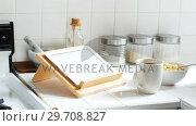 Купить «Digital tablet and cup of coffee with breakfast bowl in kitchen 4k», видеоролик № 29708827, снято 13 октября 2017 г. (c) Wavebreak Media / Фотобанк Лори