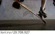 Купить «Man practicing skateboarding in skateboard arena 4k», видеоролик № 29708927, снято 10 апреля 2017 г. (c) Wavebreak Media / Фотобанк Лори