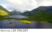 Купить «Lake surrounded by beautiful mountains 4k», видеоролик № 29709047, снято 5 августа 2017 г. (c) Wavebreak Media / Фотобанк Лори