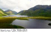 Купить «Lake surrounded by beautiful mountains 4k», видеоролик № 29709051, снято 5 августа 2017 г. (c) Wavebreak Media / Фотобанк Лори