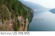 Купить «View of beautiful mountain ranges and lake 4k», видеоролик № 29709055, снято 11 августа 2017 г. (c) Wavebreak Media / Фотобанк Лори