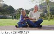 Купить «Happy grandmother and little girl sitting and using tablet 4K 4k», видеоролик № 29709127, снято 25 мая 2017 г. (c) Wavebreak Media / Фотобанк Лори
