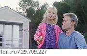 Купить «Father and daughter pointing at distance 4k», видеоролик № 29709227, снято 18 февраля 2019 г. (c) Wavebreak Media / Фотобанк Лори