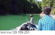 Купить «Two men riding a fishing boat in the river 4k», видеоролик № 29709251, снято 23 июня 2017 г. (c) Wavebreak Media / Фотобанк Лори