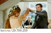 Купить «Bride and groom dancing in the hall 4k», видеоролик № 29709259, снято 2 мая 2017 г. (c) Wavebreak Media / Фотобанк Лори