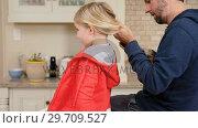 Купить «Father combing his daughter hair in the kitchen 4K 4k», видеоролик № 29709527, снято 10 августа 2017 г. (c) Wavebreak Media / Фотобанк Лори