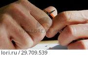 Купить «Craftsman sharpening pencil with a blade 4k», видеоролик № 29709539, снято 30 мая 2017 г. (c) Wavebreak Media / Фотобанк Лори