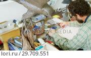 Купить «Craftsman drawing a sculpture design 4k», видеоролик № 29709551, снято 30 мая 2017 г. (c) Wavebreak Media / Фотобанк Лори