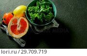 Купить «Leafy vegetable, sweet lime, lemon, tomato with measuring tape 4k», видеоролик № 29709719, снято 12 июня 2017 г. (c) Wavebreak Media / Фотобанк Лори