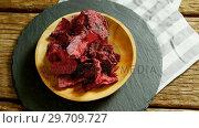 Купить «Dried beetroot in plate placed on wooden surface 4K 4k», видеоролик № 29709727, снято 12 июня 2017 г. (c) Wavebreak Media / Фотобанк Лори