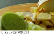Купить «Sliced ginger and lemon on a chopping board 4k », видеоролик № 29709751, снято 12 июня 2017 г. (c) Wavebreak Media / Фотобанк Лори