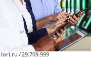 Купить «Business colleagues using electric gadgets 4k», видеоролик № 29709999, снято 19 августа 2017 г. (c) Wavebreak Media / Фотобанк Лори