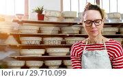 Купить «Female potter checking craft products 4k», видеоролик № 29710099, снято 6 августа 2017 г. (c) Wavebreak Media / Фотобанк Лори