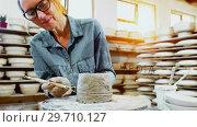 Купить «Female potter molding a clay with work tool 4k», видеоролик № 29710127, снято 6 августа 2017 г. (c) Wavebreak Media / Фотобанк Лори