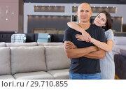 Купить «Couple standing in furniture shop», фото № 29710855, снято 29 октября 2018 г. (c) Яков Филимонов / Фотобанк Лори
