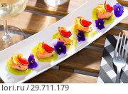 Купить «Ceviche of marinated salmon with kiwi, kumquat, figs», фото № 29711179, снято 22 августа 2019 г. (c) Яков Филимонов / Фотобанк Лори