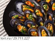 Купить «Mussels with herbs on plate», фото № 29711227, снято 25 июня 2018 г. (c) Яков Филимонов / Фотобанк Лори