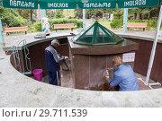 Купить «People near spring of Borjomi mineral water», фото № 29711539, снято 26 сентября 2018 г. (c) Юлия Бабкина / Фотобанк Лори