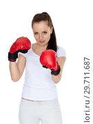 Купить «Young woman in fighting gloves», фото № 29711687, снято 22 марта 2011 г. (c) Мельников Дмитрий / Фотобанк Лори