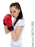 Купить «Young woman in fighting gloves», фото № 29711703, снято 22 марта 2011 г. (c) Мельников Дмитрий / Фотобанк Лори