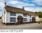 Купить «Beautiful thatched roof house in West Dorset. England», фото № 29712475, снято 12 мая 2009 г. (c) Serg Zastavkin / Фотобанк Лори