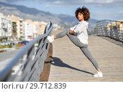Купить «Young black woman doing stretching after running outdoors», фото № 29712839, снято 20 декабря 2017 г. (c) Ingram Publishing / Фотобанк Лори