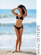 Купить «Young arabic woman with beautiful body in swimwear smiling on a tropical beach.», фото № 29712875, снято 24 сентября 2017 г. (c) Ingram Publishing / Фотобанк Лори