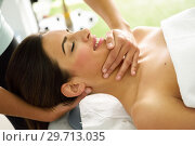 Купить «Young smiling woman receiving a head massage in a spa center.», фото № 29713035, снято 23 ноября 2017 г. (c) Ingram Publishing / Фотобанк Лори