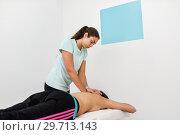 Купить «Young woman receiving a back massage in a spa center.», фото № 29713143, снято 23 ноября 2017 г. (c) Ingram Publishing / Фотобанк Лори