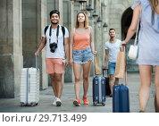 Купить «Cheerful couple in shorts with luggage», фото № 29713499, снято 22 июня 2017 г. (c) Яков Филимонов / Фотобанк Лори
