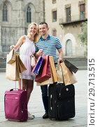 Купить «Smiling couple looking satisfied after shopping», фото № 29713515, снято 22 января 2019 г. (c) Яков Филимонов / Фотобанк Лори