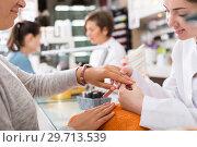 Купить «Manicurists giving manicure», фото № 29713539, снято 28 апреля 2017 г. (c) Яков Филимонов / Фотобанк Лори
