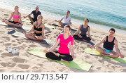Купить «People meditating in Padmasana position on seaside», фото № 29713547, снято 14 июня 2017 г. (c) Яков Филимонов / Фотобанк Лори