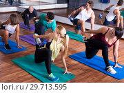 Купить «Positive people practicing yoga», фото № 29713595, снято 17 июня 2019 г. (c) Яков Филимонов / Фотобанк Лори