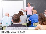 Купить «Confident lecturer talking to mixed age students», фото № 29713599, снято 28 июня 2018 г. (c) Яков Филимонов / Фотобанк Лори