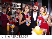 Купить «Man and two women on Hawaiian party at nightclub», фото № 29713659, снято 29 ноября 2017 г. (c) Яков Филимонов / Фотобанк Лори