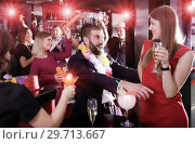 Купить «Guy flirting with girl on Hawaiian party at nightclub», фото № 29713667, снято 29 ноября 2017 г. (c) Яков Филимонов / Фотобанк Лори