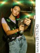 Купить «woman with laser guns took aim and posing during laser tag game», фото № 29713743, снято 23 августа 2018 г. (c) Яков Филимонов / Фотобанк Лори