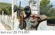 Купить «Paintball player in camouflage standing with gun after paintball match», фото № 29713851, снято 11 августа 2018 г. (c) Яков Филимонов / Фотобанк Лори