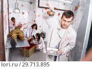 Купить «Guy frightening with medical instruments in quest room», фото № 29713895, снято 8 октября 2018 г. (c) Яков Филимонов / Фотобанк Лори