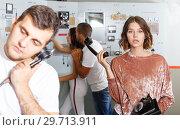 Купить «Young people with old telephone in lost room-bunker», фото № 29713911, снято 8 октября 2018 г. (c) Яков Филимонов / Фотобанк Лори