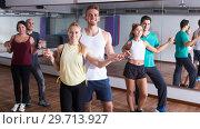 Купить «Active adults dancing salsa together in dance class», фото № 29713927, снято 27 мая 2019 г. (c) Яков Филимонов / Фотобанк Лори
