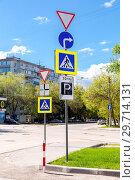 Купить «Different traffic signs on the crossroads on city street», фото № 29714131, снято 25 мая 2017 г. (c) FotograFF / Фотобанк Лори